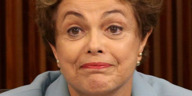 Brazil's President Dilma Rousseff gestures during a meeting with state governors regarding the impeachment...