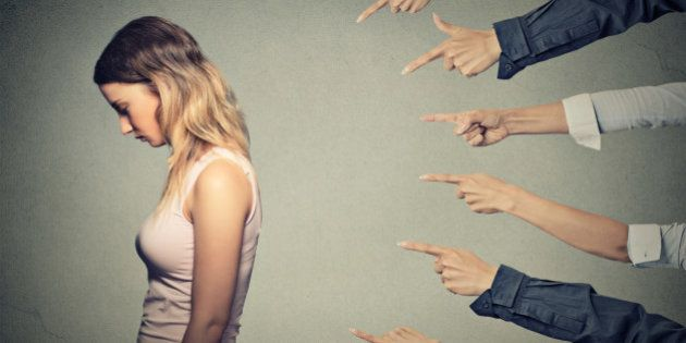 Concept of accusation guilty person girl. Side profile sad upset woman looking down many fingers pointing...