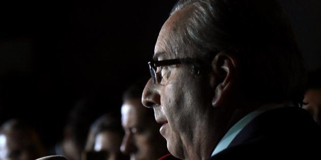 The president of the Lower House, Eduardo Cunha, speaks to the press at the Lower House's official residence...