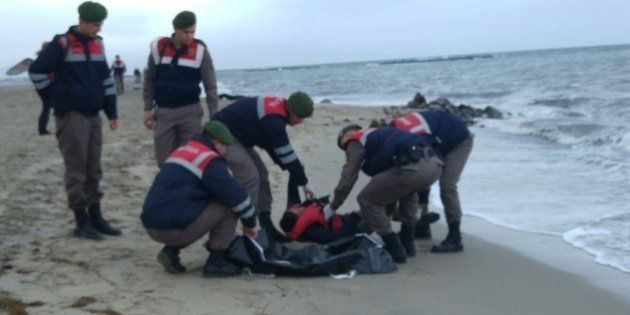 BALIKESIR, TURKEY - JANUARY 5: (EDITORS NOTE: Image depicts death) The body of a refugee is washed ashore...