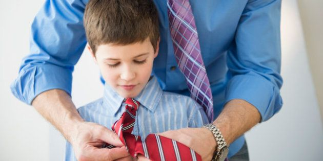 USA, New Jersey, Jersey City, Father adjusting son's (8-9) tie