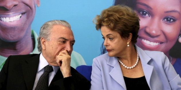 Brazil's Vice President Michel Temer talks with Brazil's President Dilma Rousseff during a ceremony for...