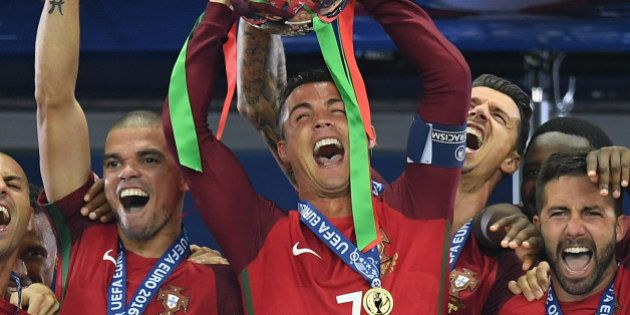 PARIS, FRANCE - JULY 10: Cristiano Ronaldo of Portugal (c) lifts the Henri Delaunay trophy after his...