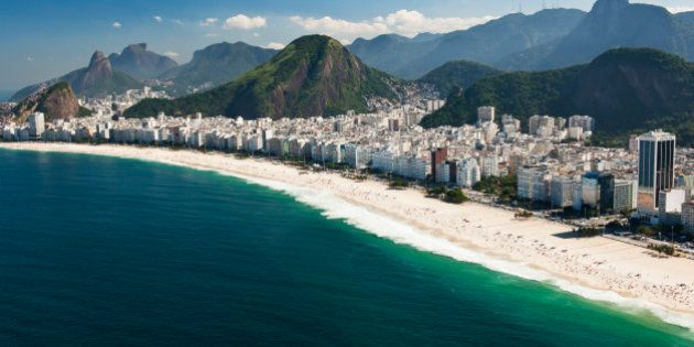 Copacabana Beach with Corcovado and 'Christ The Redeemer' in the background, aerial view. Rio de Janeiro,
