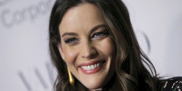 Actress Liv Tyler poses as she arrives for