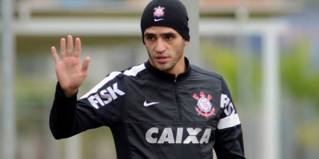 SAO PAULO, BRAZIL - JULY 23: Renato Augusto of Corinthians greets during a training session of Corinthians...