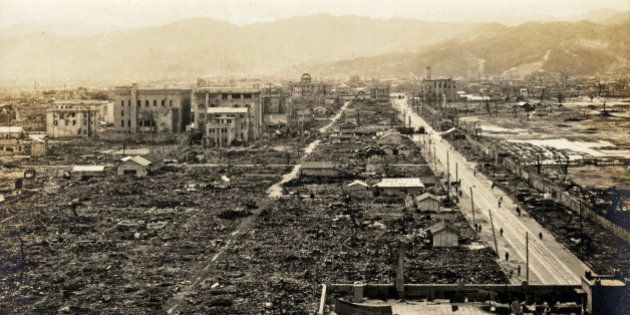 The label on the back of this image says Damage of the A-Bomb at hiroshima city - View from west parade...