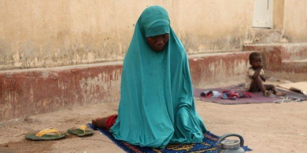 A woman rescued by Nigerian soldiers from Islamist militants Boko Haram at Sambisa Forest prays at the...