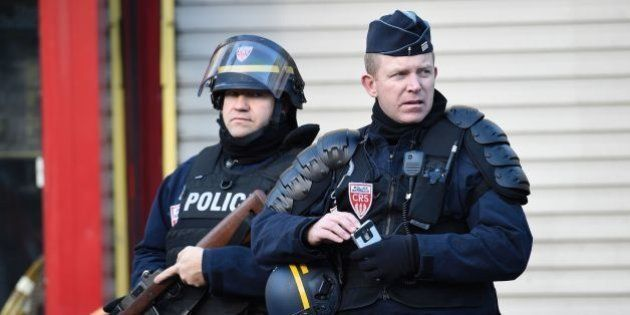 French police patrol near the Rue de la Goutte d'Or in the north of Paris on January 7, 2016, after police...