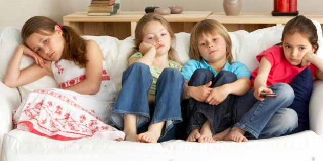Young Children Watching Television at