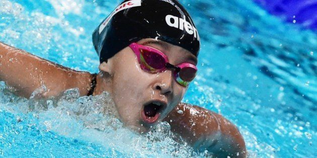 Ten years old athlete from Bahrain, Alzain Tareq, reacts after the preliminary heats of the women's 50m...