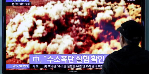A man watches a television screen showing a news broadcast on North Korea's nuclear test at Seoul Station...