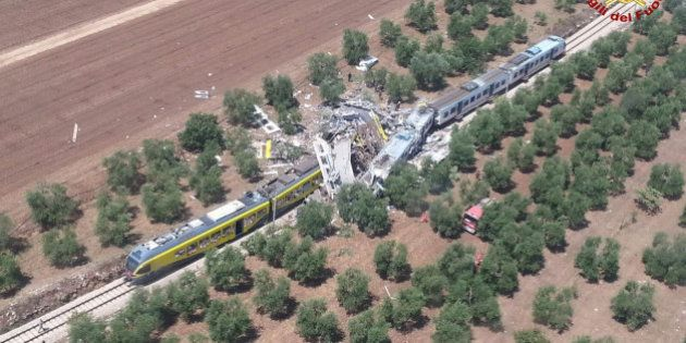 Two passenger trains are seen after a collision in the middle of an olive grove in the southern village...