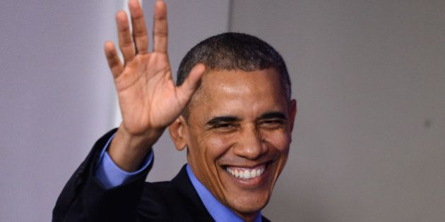 US President Barack Obama waves after a press conference in the briefing room of the White House in Washington,...