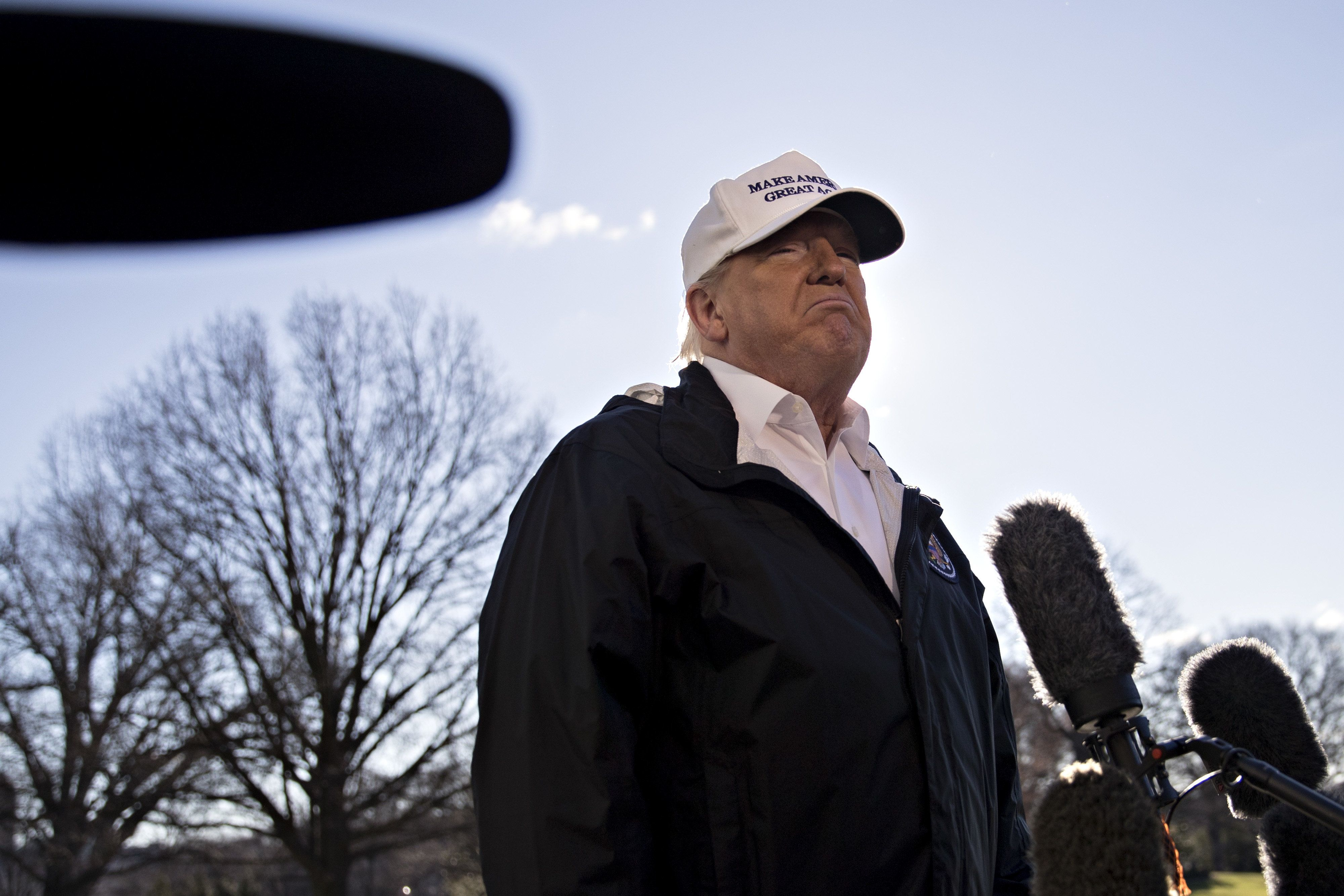 U.S. President Donald Trump pauses while speaking to members of the media on the South Lawn of the White House before boarding Marine One in Washington, D.C., U.S., on Thursday, Jan. 10, 2019. Trump heads to Texas to rally support for building a border wall a day after walking out of talks with congressional leaders on ending a partial government shutdown. The shutdown entered its 20th day on Thursday as its impact is more widely felt. Photographer: Andrew Harrer/Bloomberg via Getty Images