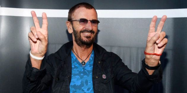 Ringo Starr poses upon arriving