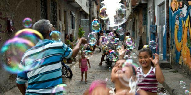 RIO DE JANEIRO, BRAZIL - 2008/01/19: Rio de Janeiro favela daily life - Seu Joao Bolinha ( Mr. John Soapbubble...