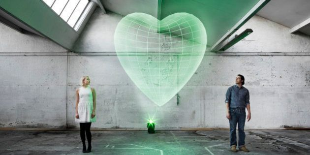 Couple in an old warehouse with a holograpic heart between