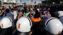FOTOS: Imigrantes e policiais entram em conflito na