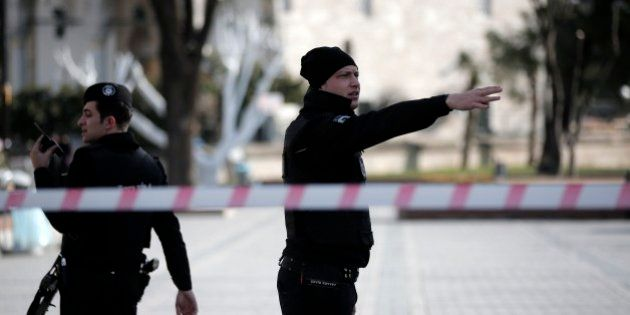 A policeman gestures as he patrols with a colleague at the historic Sultanahmet district after an explosion...