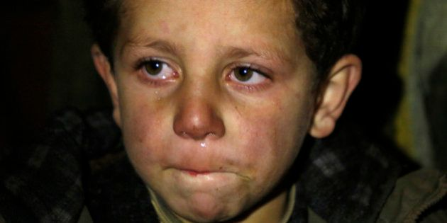 In this Monday, Jan. 11, 2016 photo, a young boy waits to be evacuated from the besieged town of Madaya,...