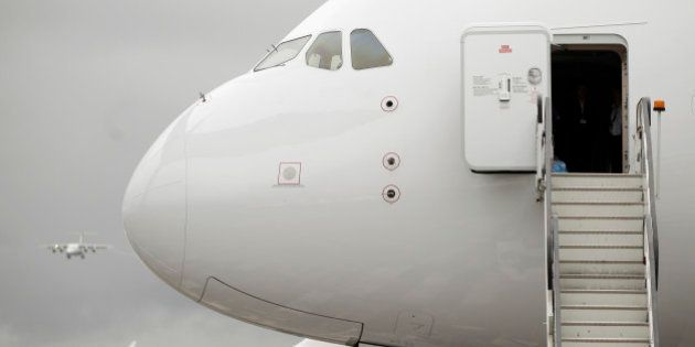 The cabin door of an Airbus SAS A380 airplane hangs open on the first day of the Farnborough International...