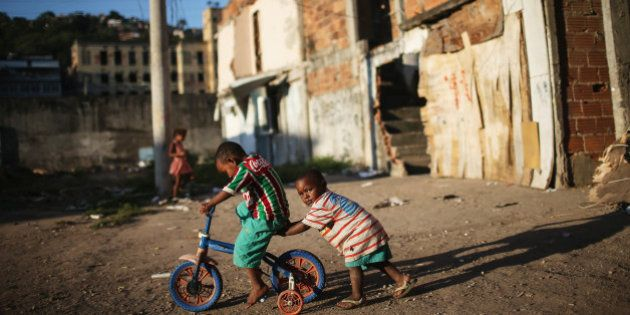 RIO DE JANEIRO, BRAZIL - JULY 24: Kids play amidst the rubble of destroyed homes in the Metro-Mangueira...