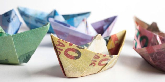 Origami boats made of brazilian money with different