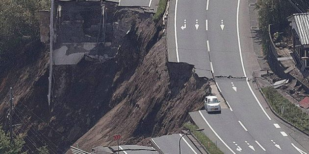 The aerial view shows a collapsed road after an earthquake in Minami-Aso, Kumamoto prefecture on April...
