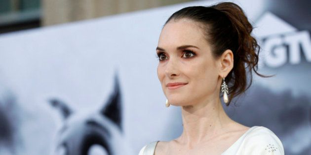 Cast member Winona Ryder poses at the premiere