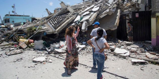 EL CARMEN, ECUADOR - APRIL 17: People try to recover what was left of their homes after an earthquake...