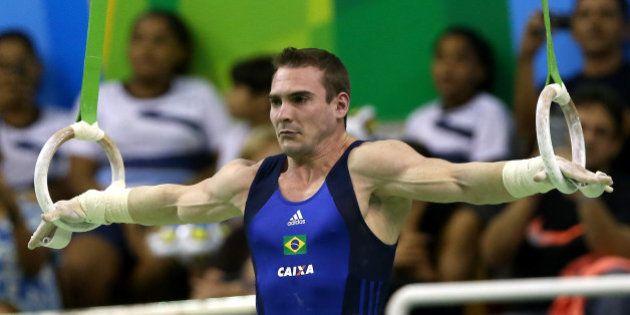 RIO DE JANEIRO, BRAZIL - APRIL 18: Arthur Zanetti of Brazil competes on the rings during the Final Gymnastics...