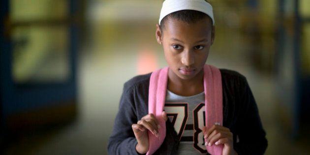 Eleven-year-old girl portrait in school