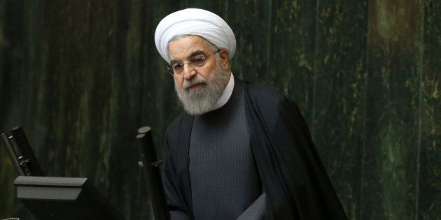 Iranian President Hassan Rouhani addresses lawmakers in an open session of parliament, in Tehran, Iran,...