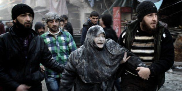 ALEPPO, SYRIA - JANUARY 16: (EDITORS NOTE: Image contains graphic content.) People help a civilian, who...