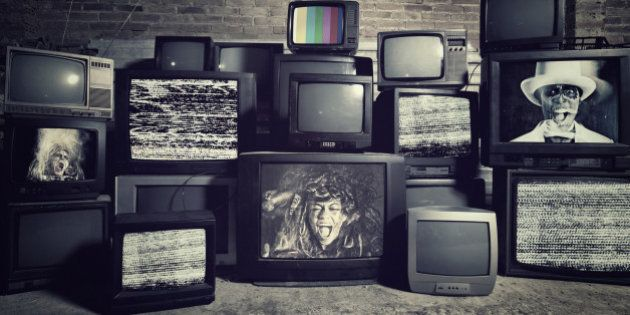 Stack televisions in a Warehouse with people screaming . All images are my Copyright