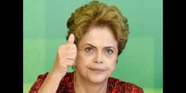 Brazilian President Dilma Rousseff gestures during a meeting with members of Brazil Popular Front, an...