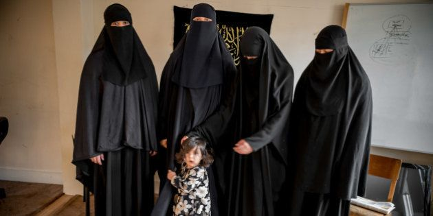 [UNVERIFIED CONTENT] Four British Muslim women from East London wear controversial full-face veils, which...