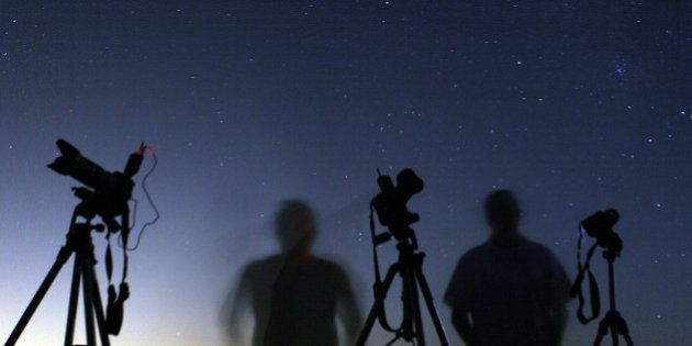 Photographers look into the dark skies to capture a shot during the Perseid Meteor shower, north of Castaic...