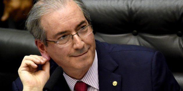 The president of the Brazilian Chamber of Deputies, Eduardo Cunha, gestures during the election of members...