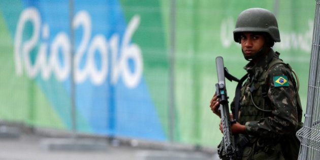 A soldier of the Brazilian Armed Forces stands guard outside the 2016 Rio Olympics Park in Rio de Janeiro,...