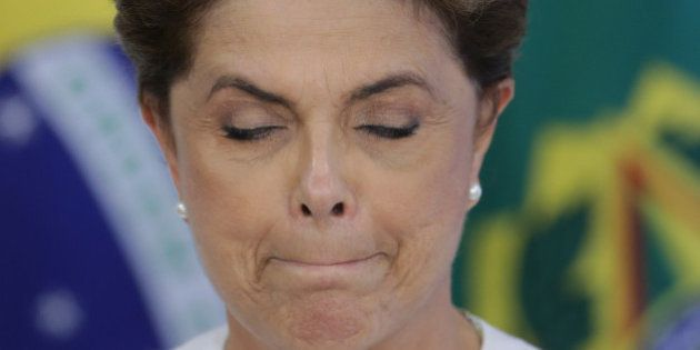 Brazil's President Dilma Rousseff briefly closes her eyes as a governor speaks during a meeting on state...