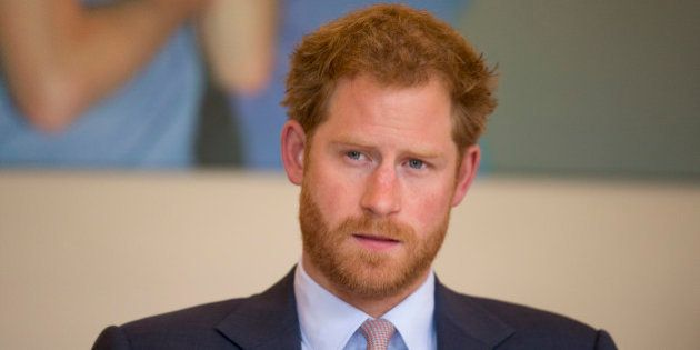 Britain's Prince Harry takes part in a round table discussion with HIV doctors at King's College Hospital...
