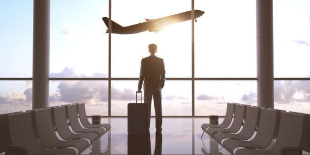 businessman in airport and airplane in