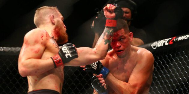 March 5, 2016; Las Vegas, NV, USA; Conor McGregor lands a punch against Nate Diaz during UFC 196 at MGM...