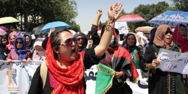 KABUL, AFGHANISTAN-JULY 23: Afghan protesters from Hazara minority shout slogans during a protest against...