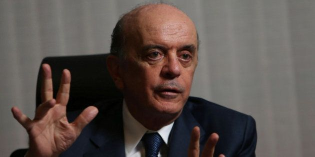 Brazilian Foreign Minister Jose Serra gestures during an interview with Reuters at the Itamaraty Palace...