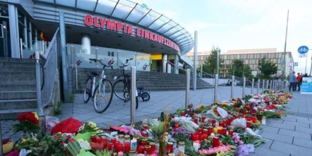Picture taken on July 24, 2016 shows a memorial of candles and flowers laid down in front of the Olympia...