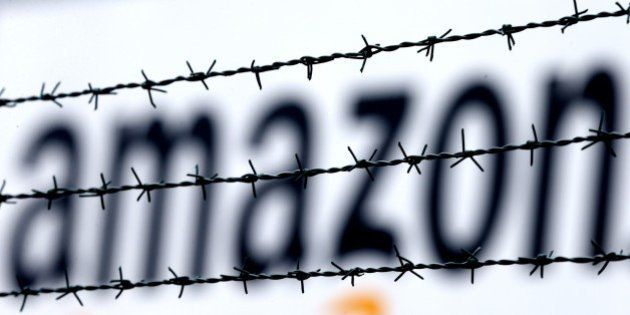 The internet trader Amazon logo is seen behind barbed wire at the company's logistic center in Rheinberg,Germany,...
