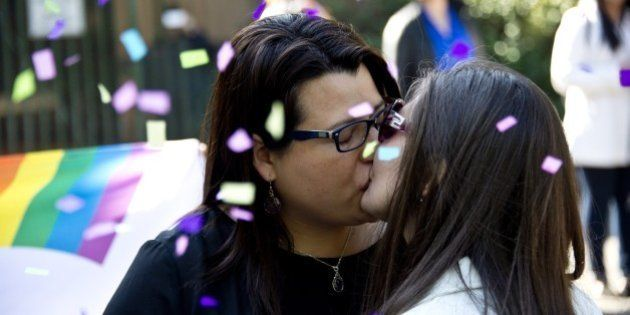 Roxana Ortiz (L) and Virginia Gomez kiss each other after their Civil Marriage ceremony at the Registry...